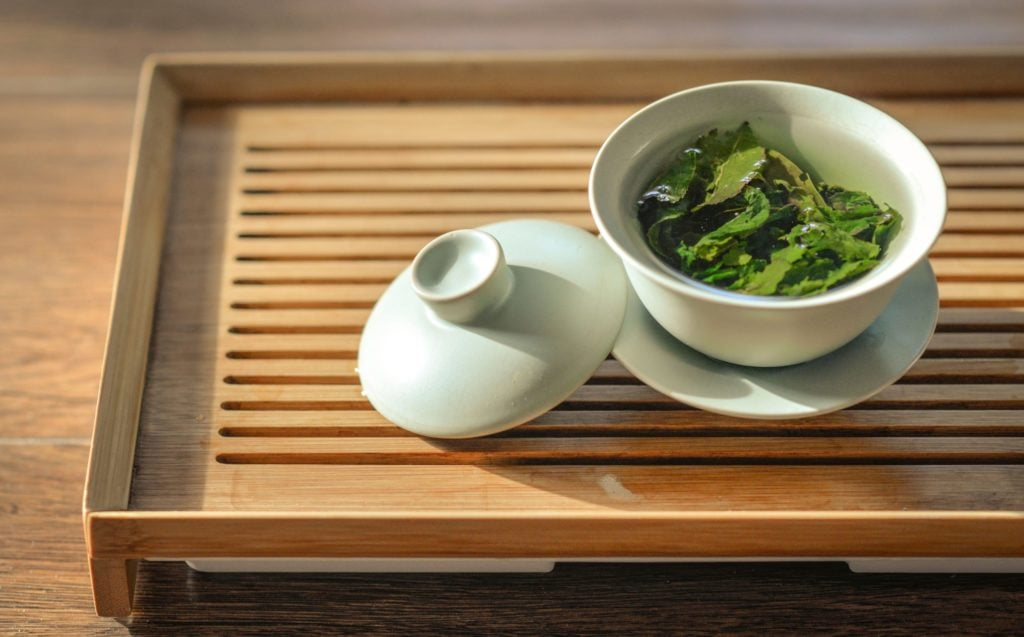 The health benefits of this green tea on a wooden table can boost your immune system naturally to reduce inflammation