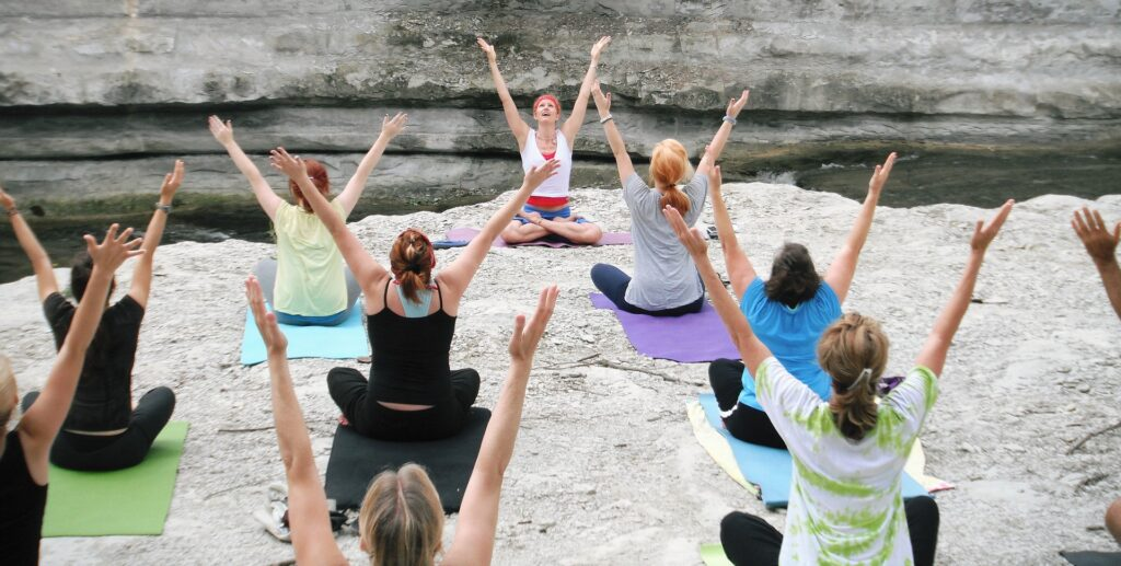 Women practicing yoga for chronic stress reduction