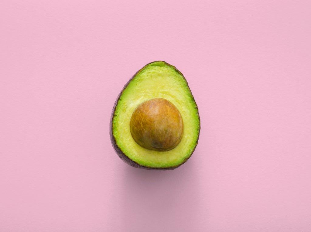 Avocado on pink background