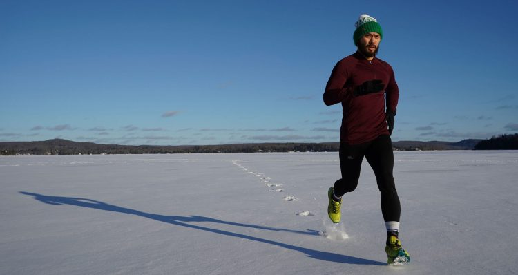 A man running in winter landscape to lower cortisol levels